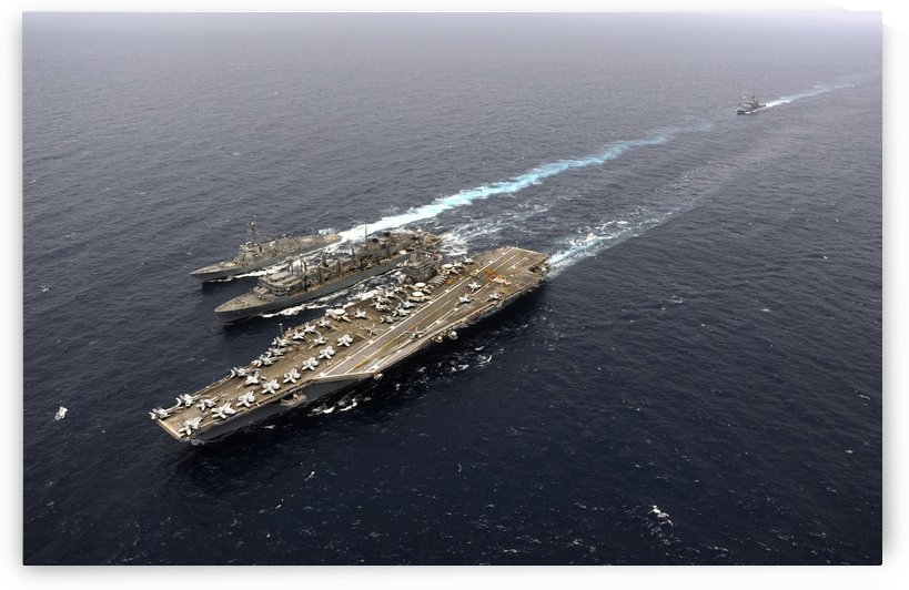 An underway replenishment with ships of the  John C. Stennis Carrier Strike Group. by StocktrekImages