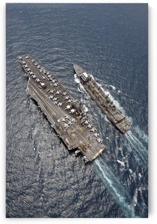 Aerial view of aircraft carrier USS Ronald Reagan and USNS Bridge during a replenishment at sea. by StocktrekImages
