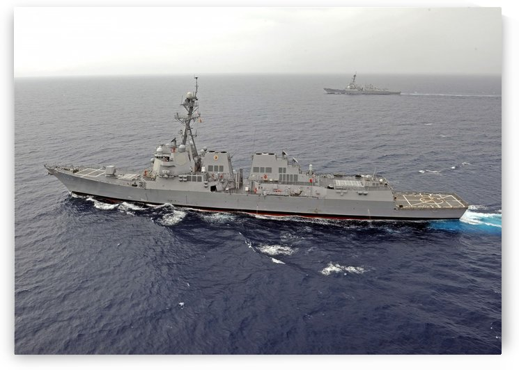 Guided missile destroyers USS Dewey and USS Pinckney transit the South China Sea. by StocktrekImages
