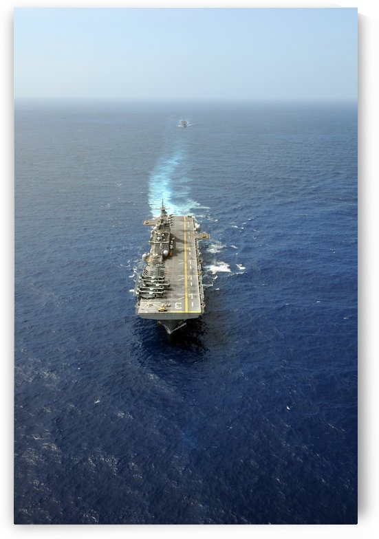 The Kearsarge Amphibious Ready Group executes a column maneuver in the Atlantic Ocean. by StocktrekImages