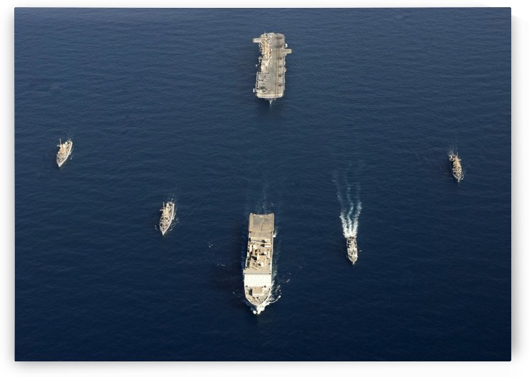 A formation of ships at sea. by StocktrekImages