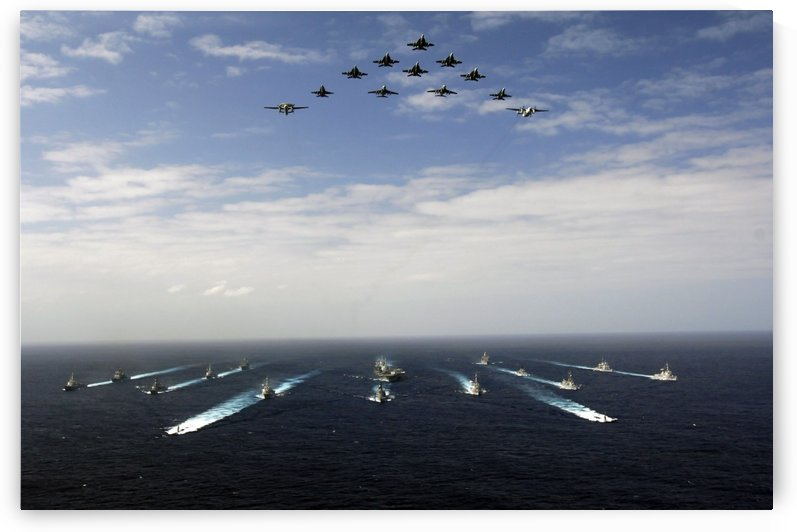 Aircraft fly over a group of U.S. and Japanese Maritime Self-Defense Force ships. by StocktrekImages