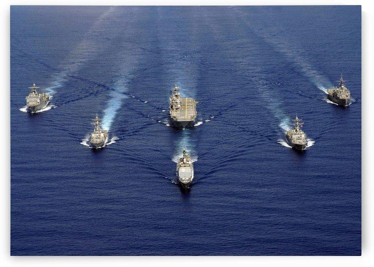 Ships of the Nassau Strike Group transit westward in the Atlantic Ocean. by StocktrekImages