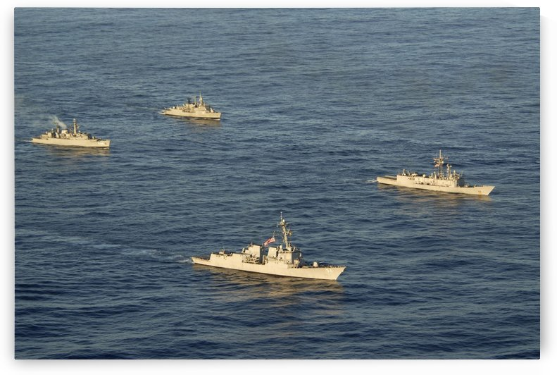 Multinational Navy ships move into formation during UNITAS 52 in the Atlantic Ocean. by StocktrekImages