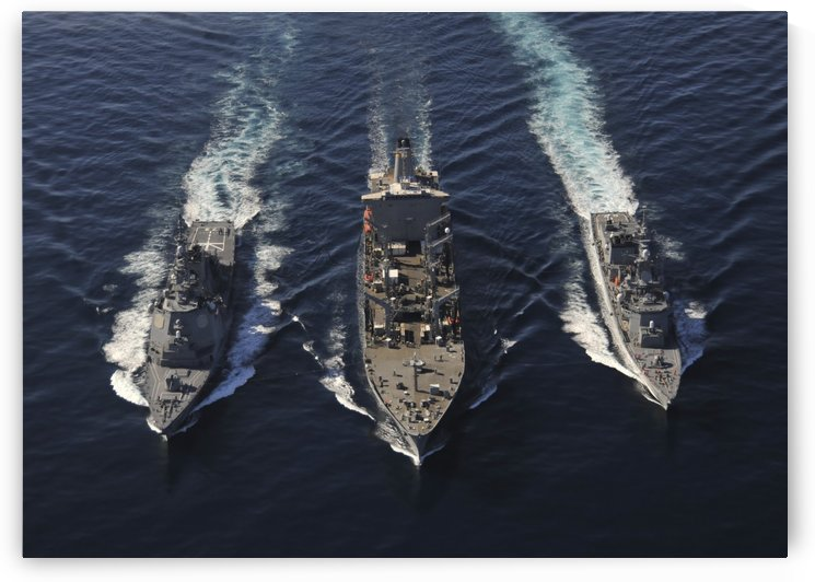 Ships of the George Washington Carrier Strike Group transit the Pacific Ocean. by StocktrekImages