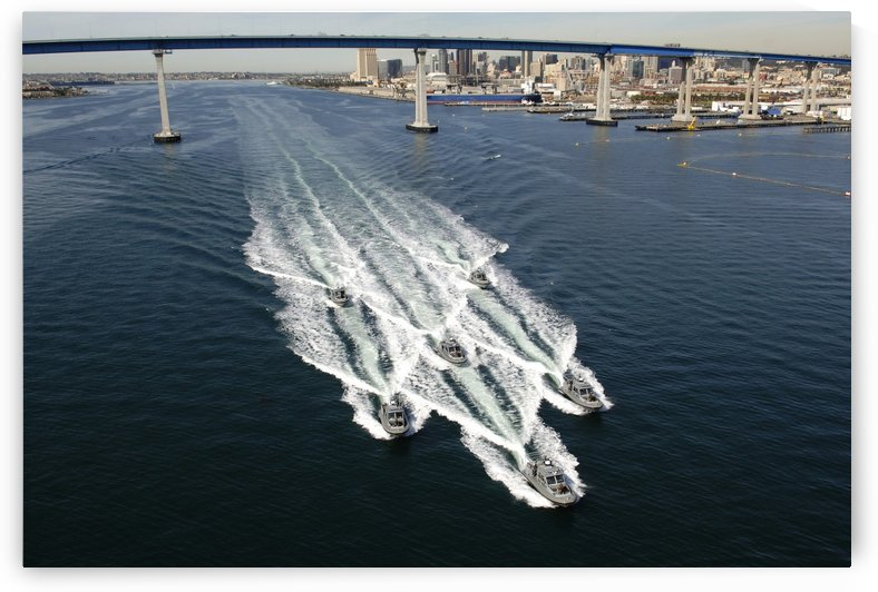 U.S. Navy patrol boats conduct operations near the Coronado Bay Bridge in San Diego California. by StocktrekImages
