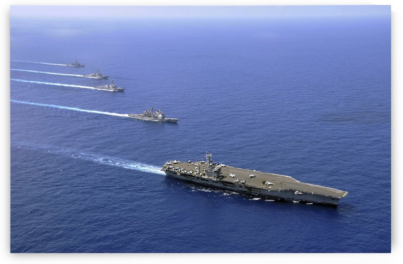 Military ships operate in formation in the South China Sea. by StocktrekImages