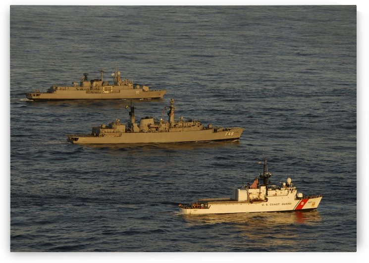A convoy of naval ships move into formation during UNITAS 52 in the Atlantic Ocean. by StocktrekImages