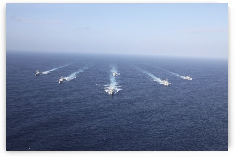 Military ships transit the Philippine Sea in formation. by StocktrekImages