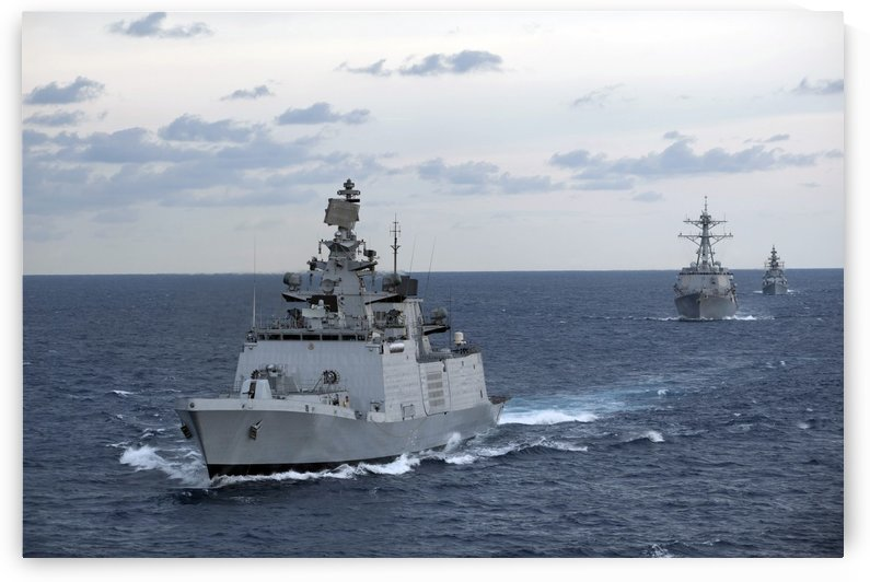 The Indian Navy frigate INS Satpura is underway with U.S. Navy ships. by StocktrekImages