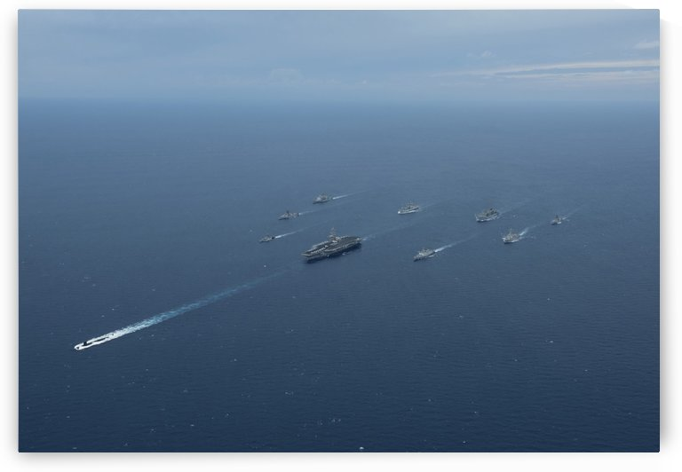 Carrier Strike Group formation of ships in the Bay of Bengal. by StocktrekImages