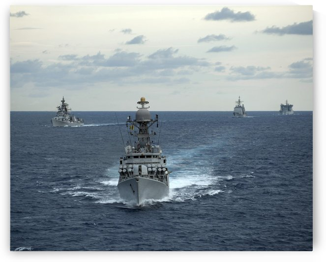 Indian Navy corvette ship INS Kulish leads a group of U.S. Navy ships. by StocktrekImages