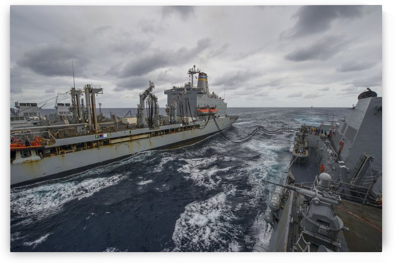 USS Truxtun participates in an underway replenishment with USNS Patuxent. by StocktrekImages