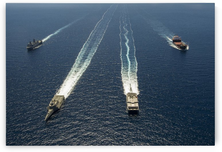 Military ships in formation off the coast of Southern California. by StocktrekImages