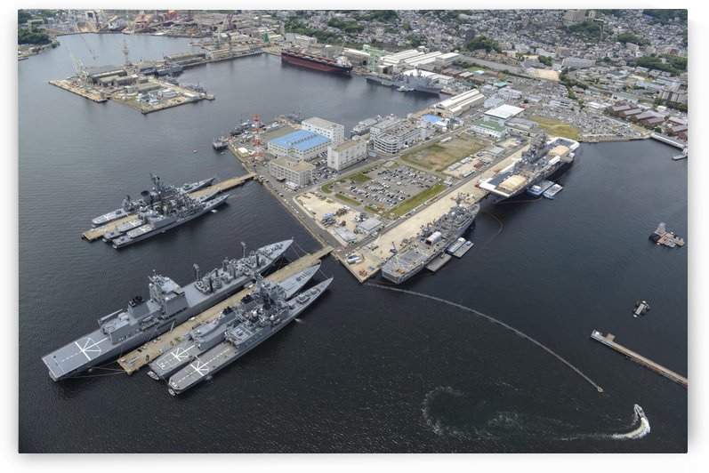 Aerial view of military ships moored at Sasebo Japan. by StocktrekImages