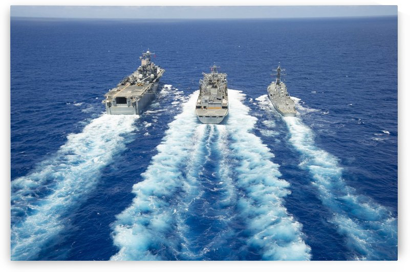 USS Peleliu and USS Spruance conduct a replenishment at sea with USNS Rainier. by StocktrekImages