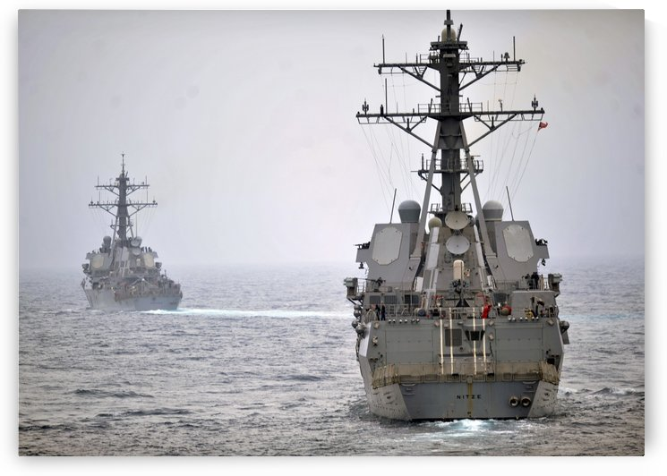 USS Porter and USS Nitze participate in a simulated strait transit exercise. by StocktrekImages