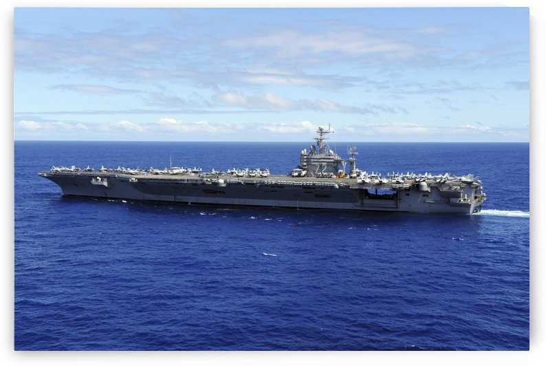 The aircraft carrier USS Abraham Lincoln transits across the Pacific Ocean. by StocktrekImages