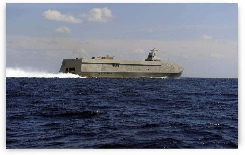 The Sea Fighter littoral combat ship performs a high-speed run off the coast of Florida. by StocktrekImages