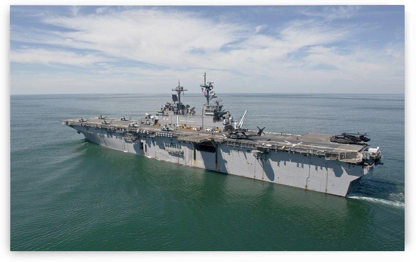 The amphibious assault ship USS Wasp transits the Atlantic Ocean. by StocktrekImages
