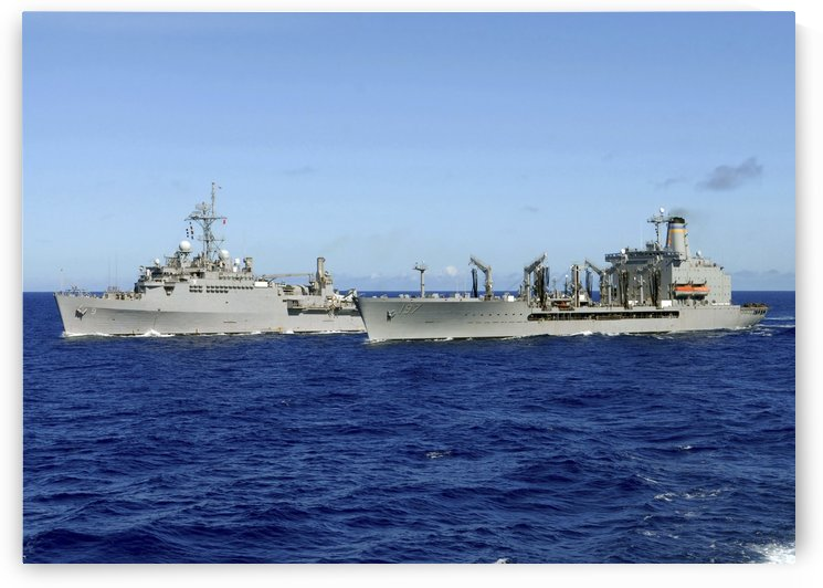 USS Denver and USNS Pecos conduct a replenishment at sea. by StocktrekImages