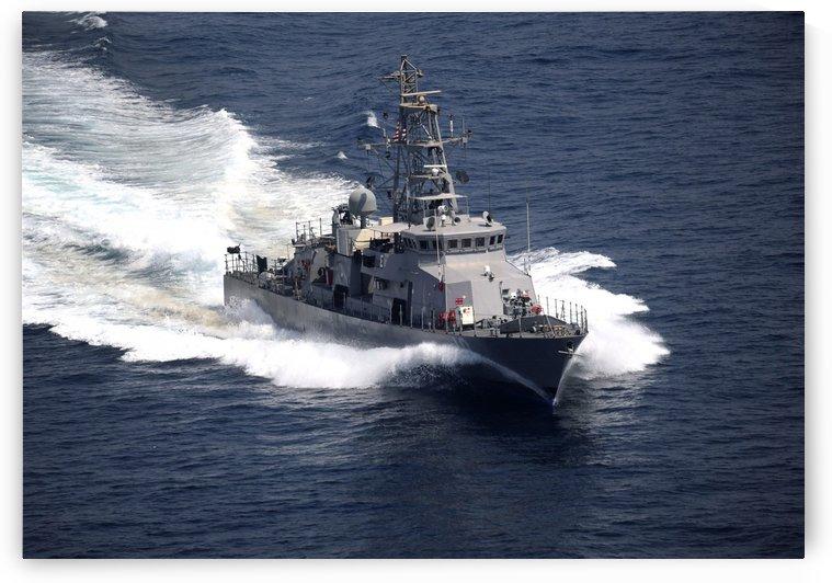 The cyclone-class coastal patrol ship USS Firebolt transits the Arabian Gulf. by StocktrekImages