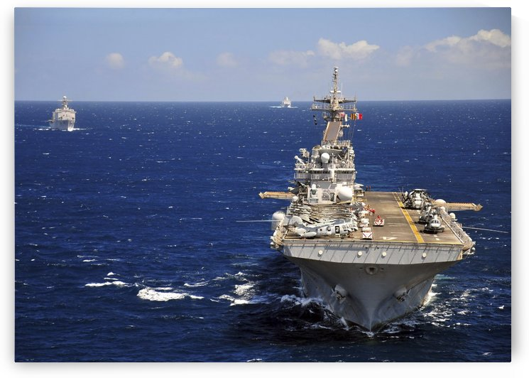 USS Boxer leads a convoy of ships in the Indian Ocean. by StocktrekImages