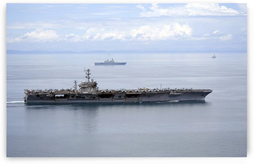 The aircraft carrier USS George Washington underway in the Yellow Sea. by StocktrekImages
