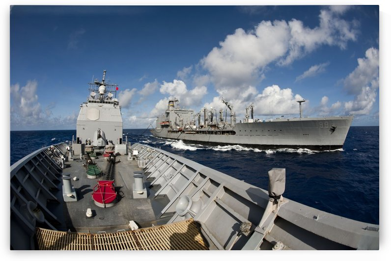 USS Cowpens transits alongside USNS Tippecanoe. by StocktrekImages