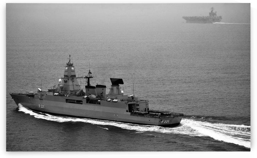 German navy frigate FGS Hessen cruises alongside USS Harry S. Truman. by StocktrekImages