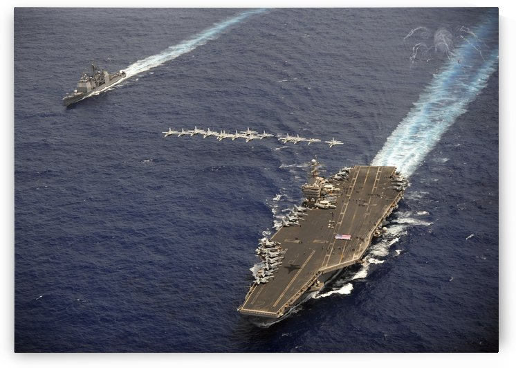 F-A-18 Hornets fly in formation over USS Abraham Lincoln and USS Cape St. George. by StocktrekImages