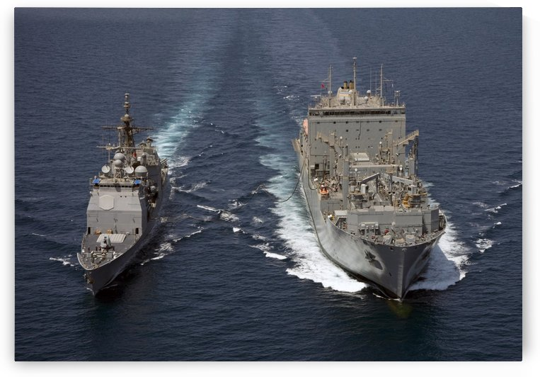 USS Cape St. George pulls alongside USNS Charles Drew for a replenishment at sea. by StocktrekImages