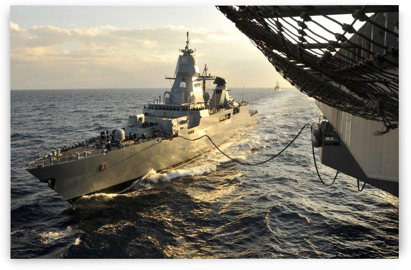 German Sachsen-class frigate Hessen conducts an underway replenishment. by StocktrekImages