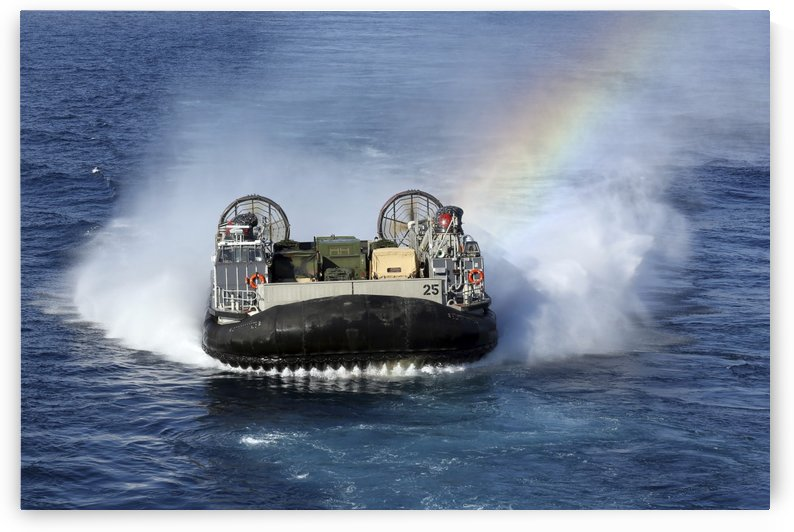 A landing craft air cushion transits the Atlantic Ocean. by StocktrekImages