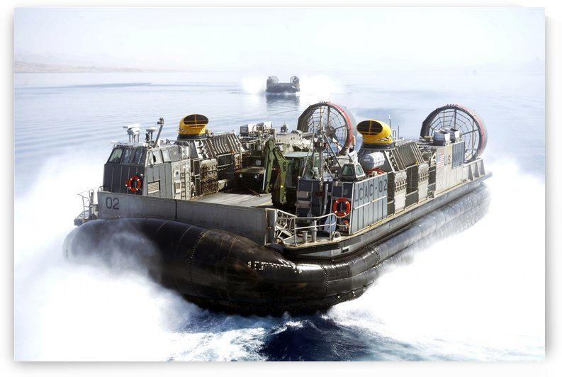 Landing craft air cushions conduct operations in the Gulf of Aqaba. by StocktrekImages
