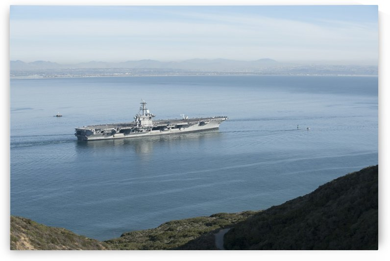 USS Carl Vinson gets underway from Naval Air Station North Island. by StocktrekImages