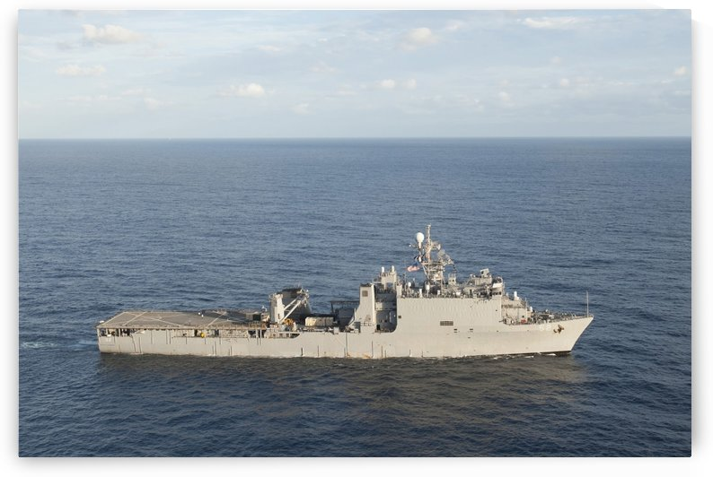 Amphibious dock landing ship USS Pearl Harbor transits the Pacific Ocean. by StocktrekImages