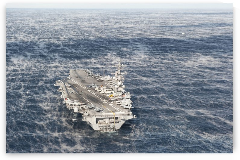 USS George H.W. Bush sails in the Atlantic Ocean. by StocktrekImages