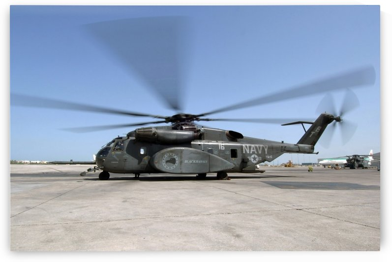 An MH-53E Sea Dragon helicopter sits ready on the flight line. by StocktrekImages