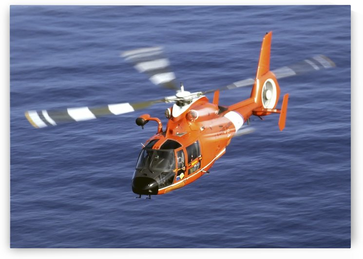 A Coast Guard HH-65A Dolphin rescue helicopter in flight. by StocktrekImages