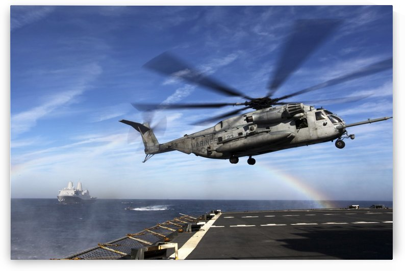 A CH-53E Super Stallion prepares to land on USNS Arctic. by StocktrekImages