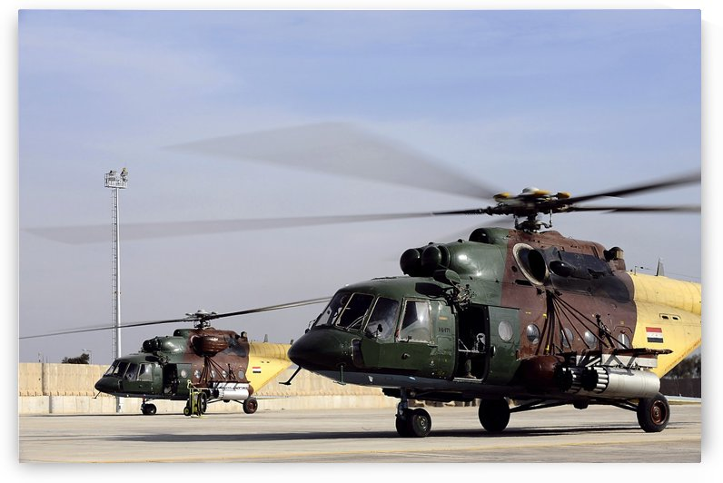Two Iraqi Mi-17 Hip Helicopters conduct an aeromedical evacuation mission. by StocktrekImages