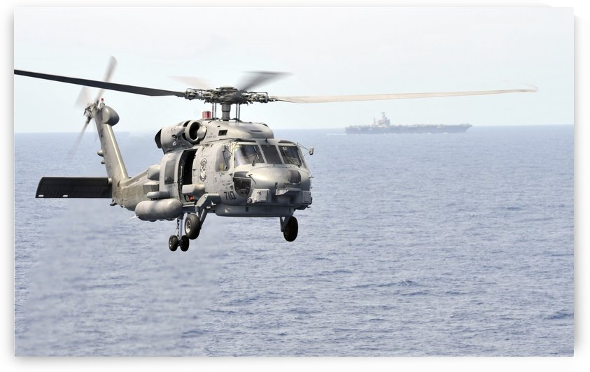 An MH-60R Seahawk helicopter in flight over the Pacific Ocean. by StocktrekImages