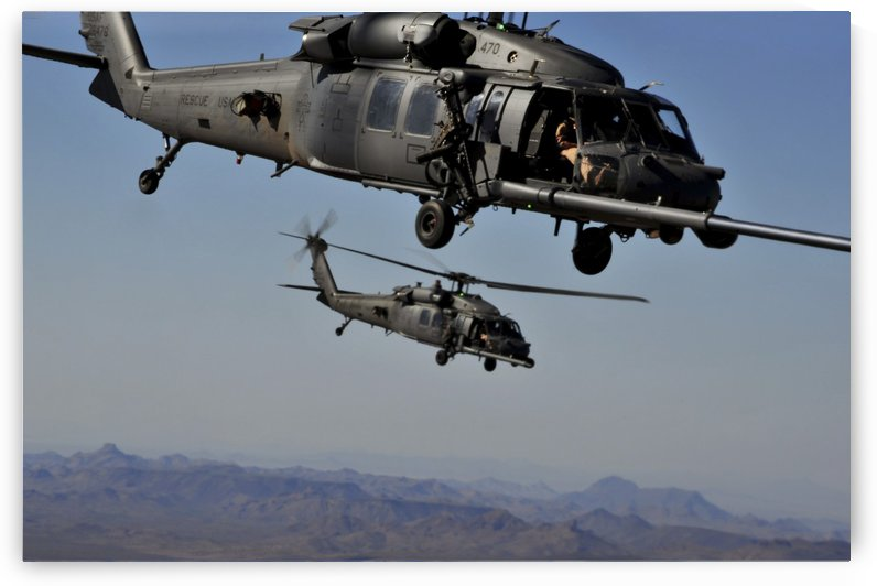 Two HH-60 Pave Hawk helicopters prepare for aerial refueling. by StocktrekImages