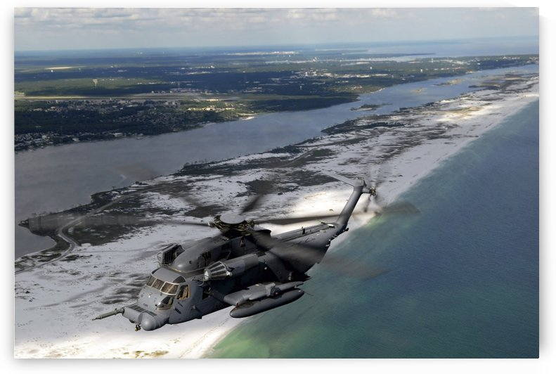 An MH-53 Pave Low flies over the coastline of Florida. by StocktrekImages