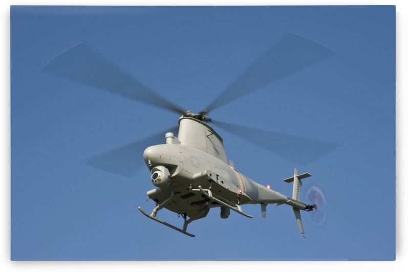 An MQ-8B Fire Scout unmanned aerial vehicle in flight. by StocktrekImages