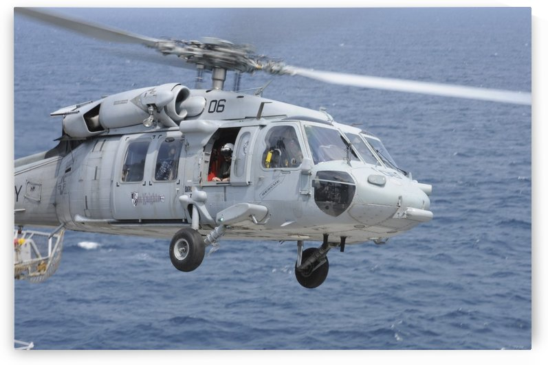 An MH-60S Sea Hawk search and rescue helicopter. by StocktrekImages