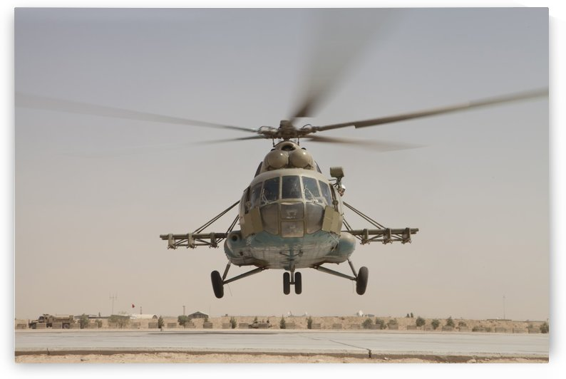 An Afghan Air Force Russian Mil MI-17 helicopter takes off from Camp Shorabak Afghanistan. by StocktrekImages