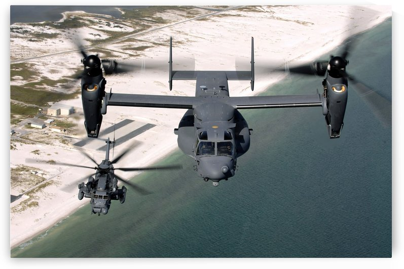 A CV-22 Osprey and an MH-53 Pave Low fly over the coastline of Florida. by StocktrekImages