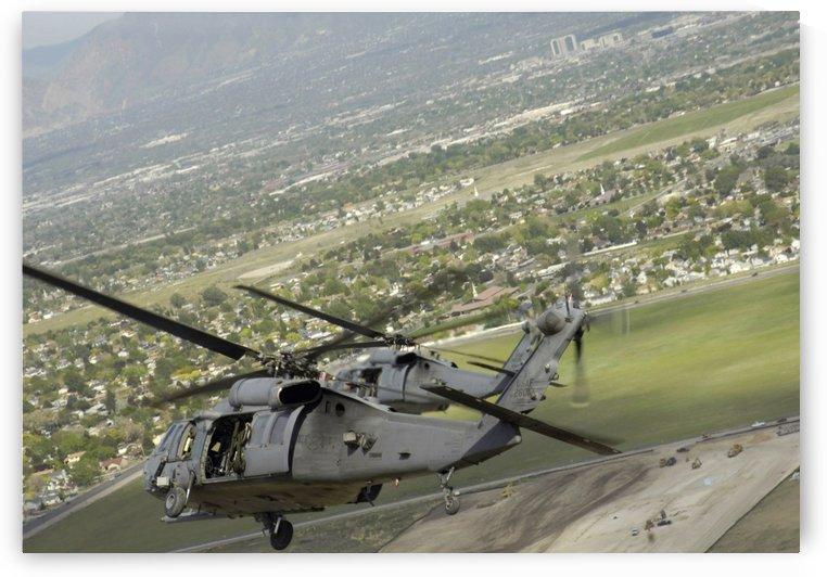 HH-60 Pave Hawks in flight over Utah. by StocktrekImages
